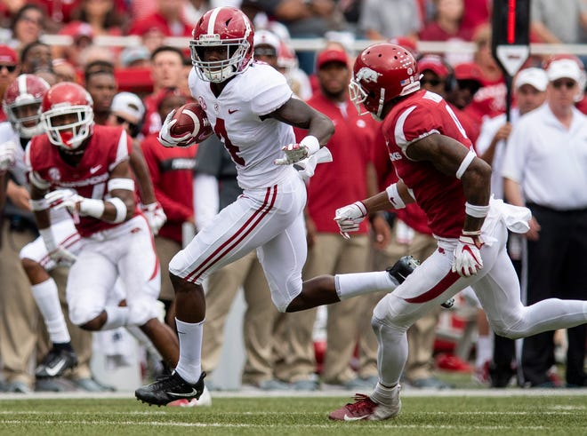 Alabama wide receiver Jerry Jeudy (4) breaks free for a touchdown late in the second quarter against Arkansas in Fayetteville, Ark., on Saturday October 6, 2018.