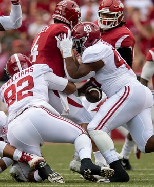 Arkansas quarterback Ty Storey (4)  fumbles the ball as he is hit Alabama defensive linemen Isaiah Buggs (49) and  lineman Quinnen Williams (92) during first half action in Fayetteville, Ark., on Saturday October 6, 2018.