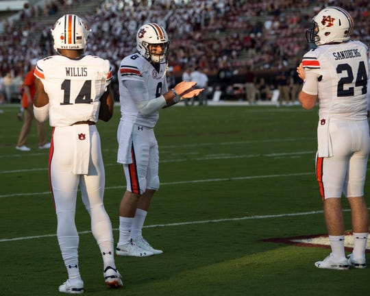 Auburn quarterbacks Malik Willis (left), Jarrett Stidham (center) and Cord Sandberg (right) warm up before taking on Mississippi State at Davis Wade Stadium in Starkville, Miss., on Saturday, Oct. 6, 2018.