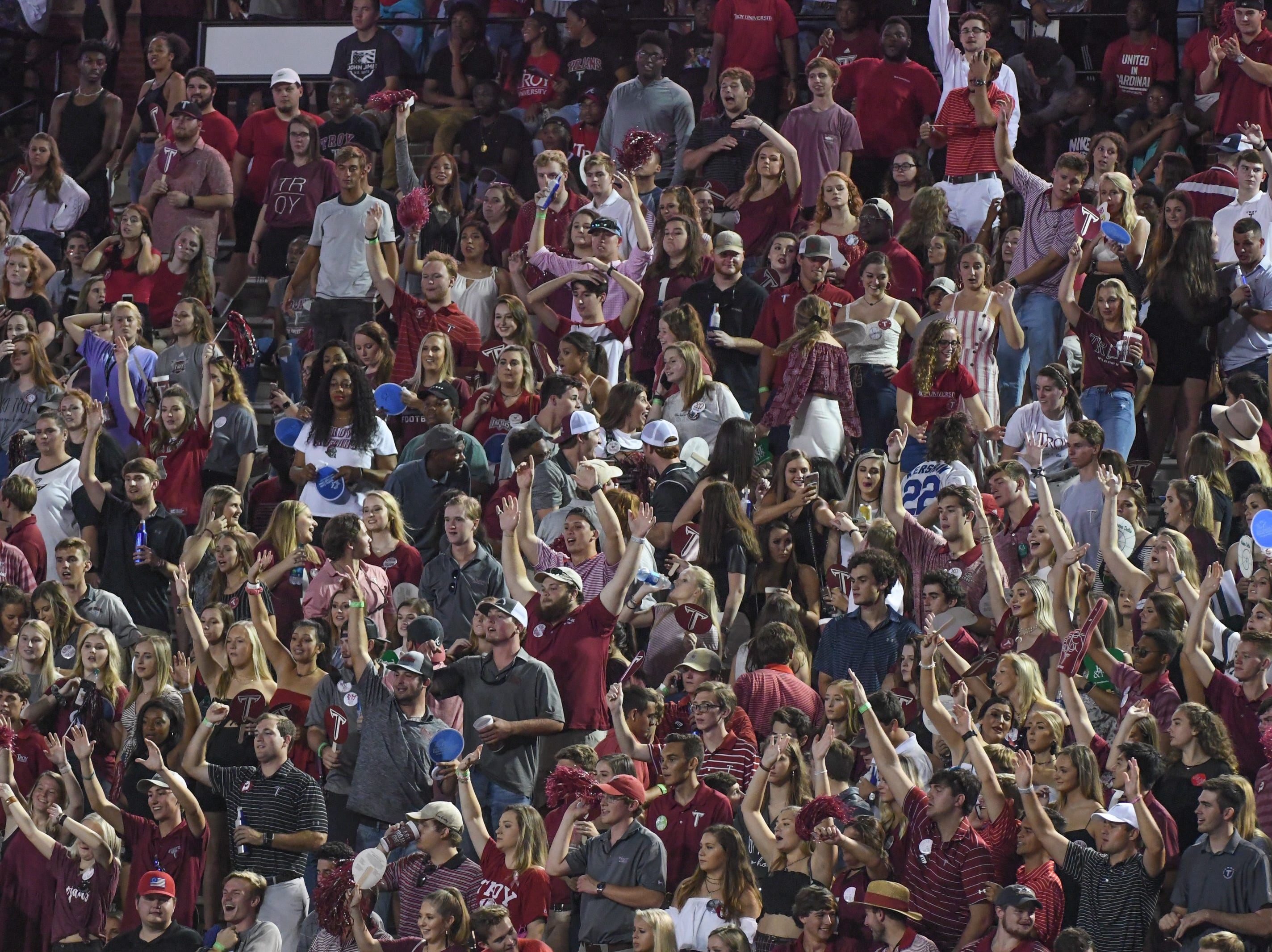 The Troy student section celebrates a Troy touchdown against Georgia State at Veteran's Memorial Stadium in Troy, Ala., on Thursday, Oct. 4, 2018. (Chip Dillard/Special to the Montgomery Advertiser)