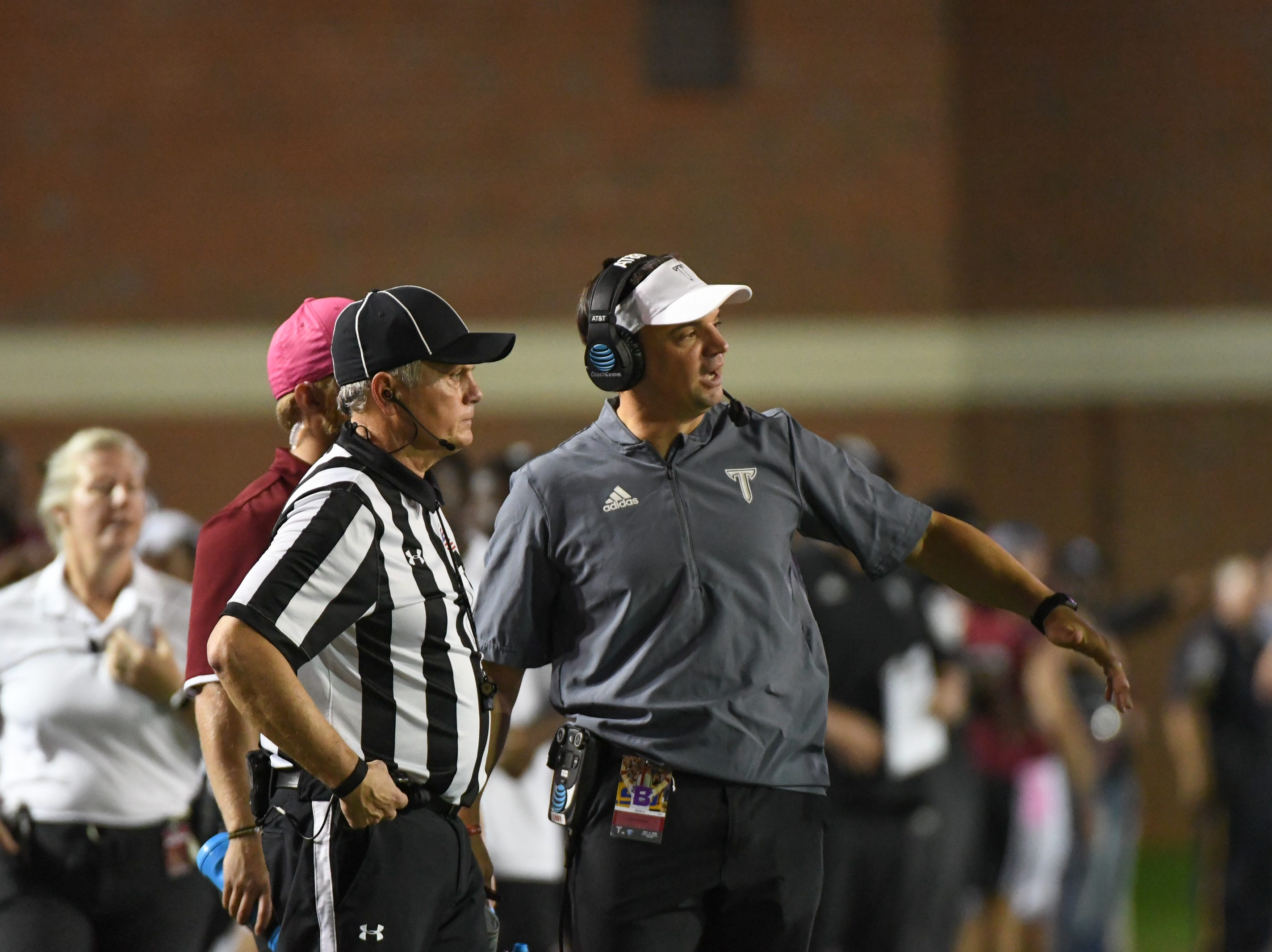 Troy Head Coach Neal Brown talks to the ref about a call against Georgia State at Veteran's Memorial Stadium in Troy, Ala., on Thursday, Oct. 4, 2018. (Chip Dillard/Special to the Montgomery Advertiser)