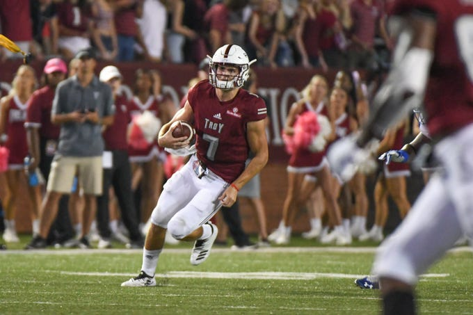 Troy Trojans quarterback Kaleb Barker (7) breaks for a run down field against Georgia State at Veteran's Memorial Stadium in Troy, Ala., on Thursday, Oct. 4, 2018. (Chip Dillard/Special to the Montgomery Advertiser)