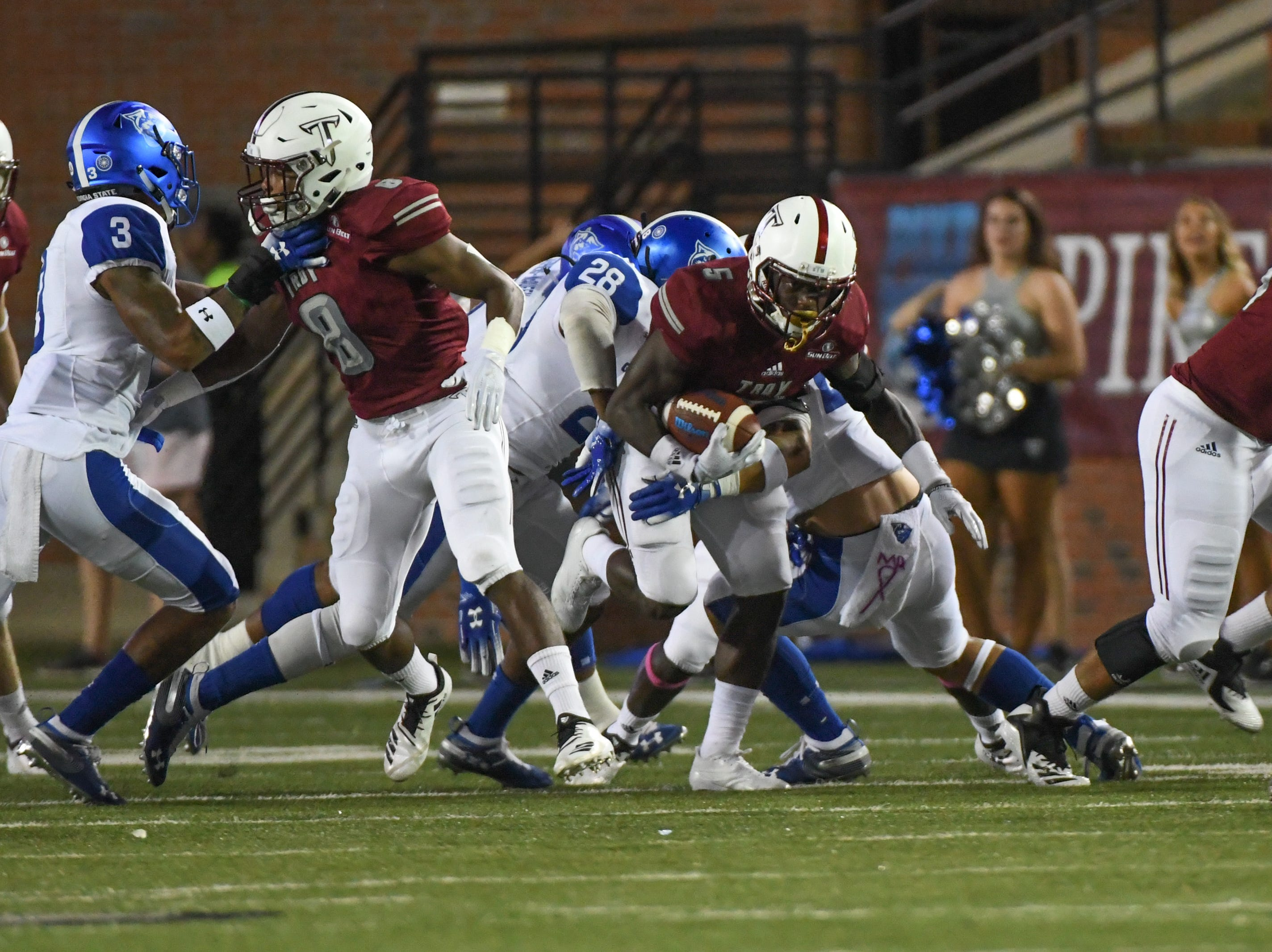 Troy Trojans running back Jabir Daughtry-Frye (5) is tackled by Georgia State defense  at Veteran's Memorial Stadium in Troy, Ala., on Thursday, Oct. 4, 2018. (Chip Dillard/Special to the Montgomery Advertiser)