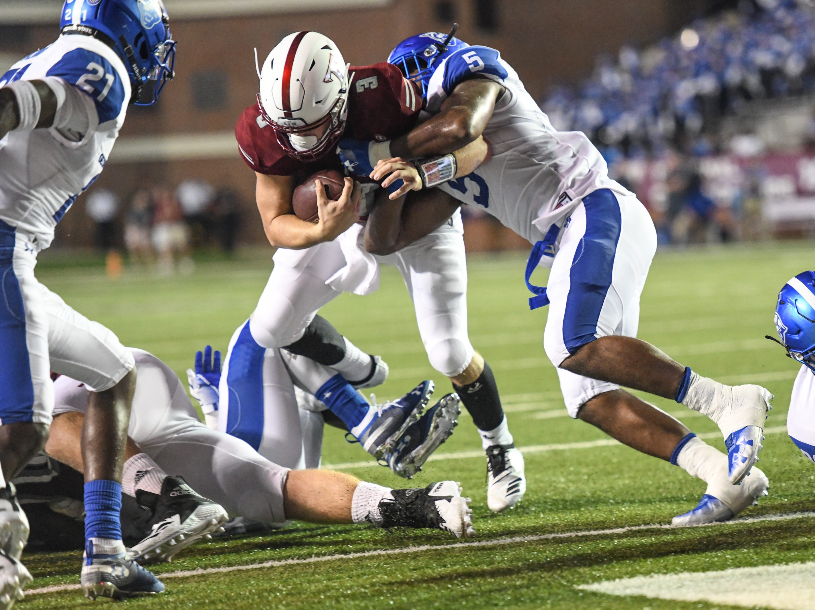 Troy Trojans quarterback Sawyer Smith (3) is stopped at the line by Georgia State Panthers linebacker Chase Middleton (5) during the first half at Veteran's Memorial Stadium in Troy, Ala., on Thursday, Oct. 4, 2018. (Chip Dillard/Special to the Montgomery Advertiser)