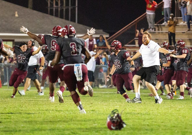 Stanhope players and coaches celebrate a win against Wetumpka, leaving the Indians with their first loss of the season.