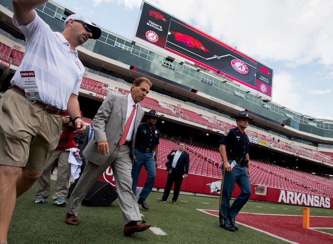 Alabama head coach Nick Saban walks the field before the Alabama vs. Arkansas game in Fayetteville, Ark., on Saturday October 6, 2018.