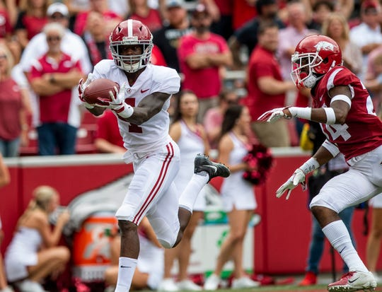 Alabama wide receiver Jerry Jeudy (4) catches a long touchdown pass against Arkansas defensive back Jarques McClellion (24) during first half action in Fayetteville, Ark., on Saturday October 6, 2018.