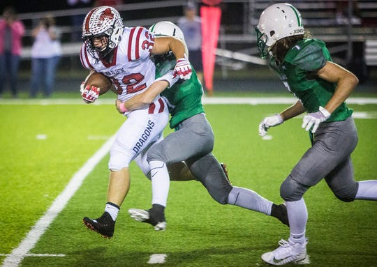 New Palestine's Charlie Spegal pushes past New Castle's defense during their game at New Castle High School Friday, Oct. 5, 2018.