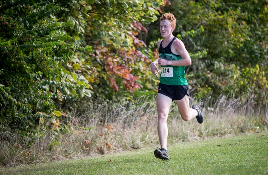 FILE -- Yorktown's Matthew Mitsch paces the field during the boys cross country sectional at the Muncie SportsPlex on Oct. 6, 2018. Mitsch won the individual title.
