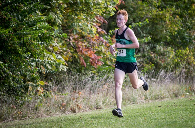 Yorktown's Matthew Mitsch paces the field during the boys cross country sectional at the Muncie SportsPlex on Oct. 6, 2018. Mitsch won the individual title.