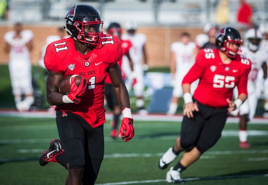 Ball State's Ray Wilborn runs after intercepting a pass against Northern Illinois during their game at Scheumann Stadium Saturday, Oct. 6, 2018.