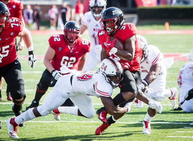 Ball State's James Gilbert fights for yards past Northern Illinois' defense during their game at Scheumann Stadium Saturday, Oct. 6, 2018.