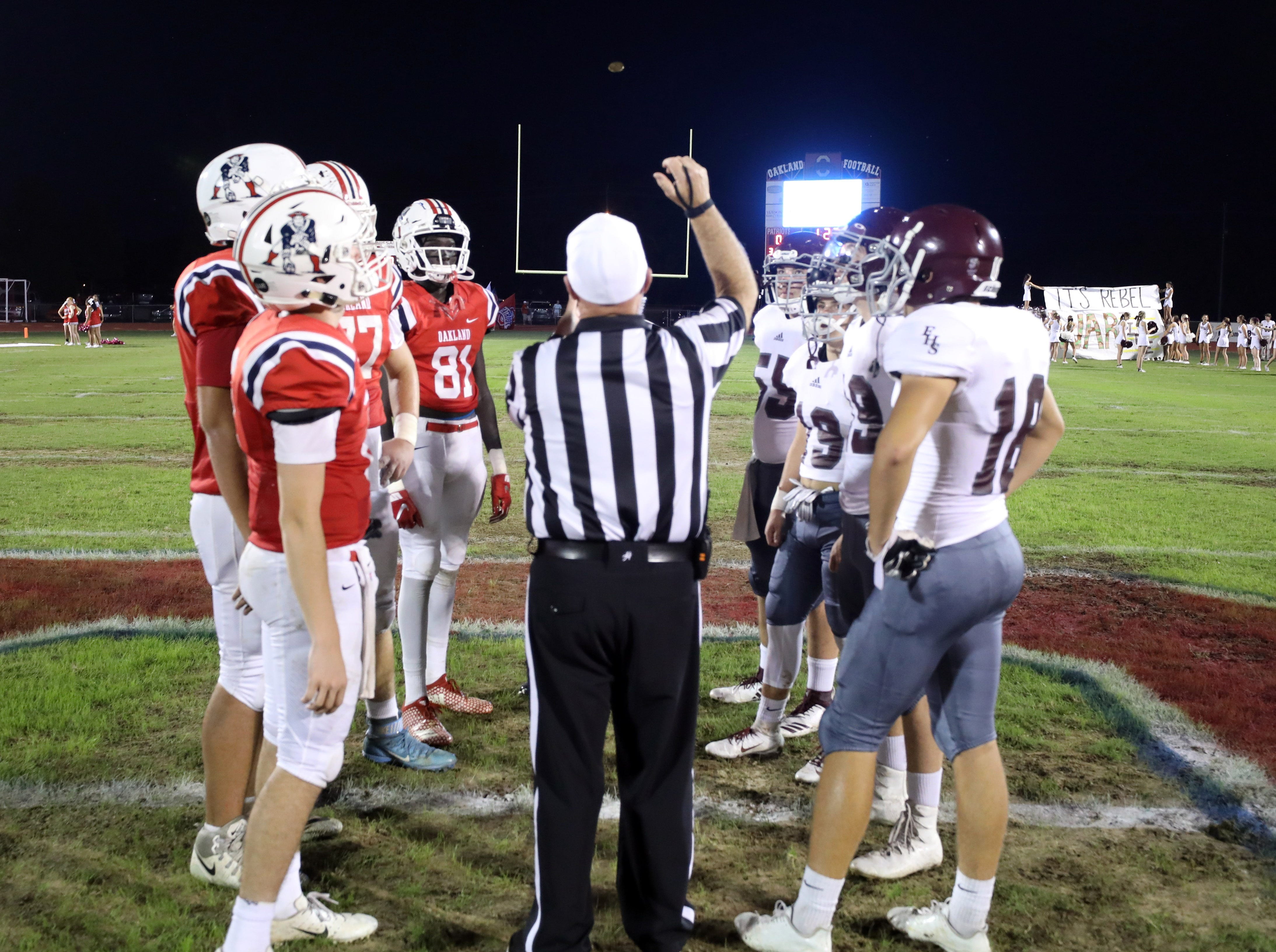 Captains for Oakland and Franklin participate in the coin toss before the start of their game at Oakland High School in Murfreesboro Friday October 5, 2018.