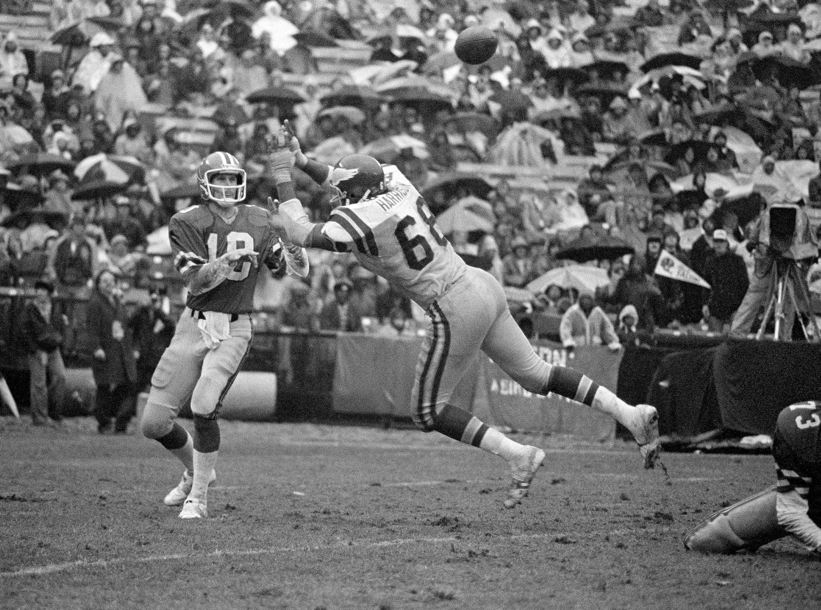 Philadelphia Eagles' Dennis Harrison (68) fails to stop the throw of Atlanta Falcons' Steve Bartkowski in the third quarter of the NFC Wildcard Playoff game in Atlanta Fulton County Stadium, Dec. 24, 1978. The Falcons defeated the Eagles, 14-13.