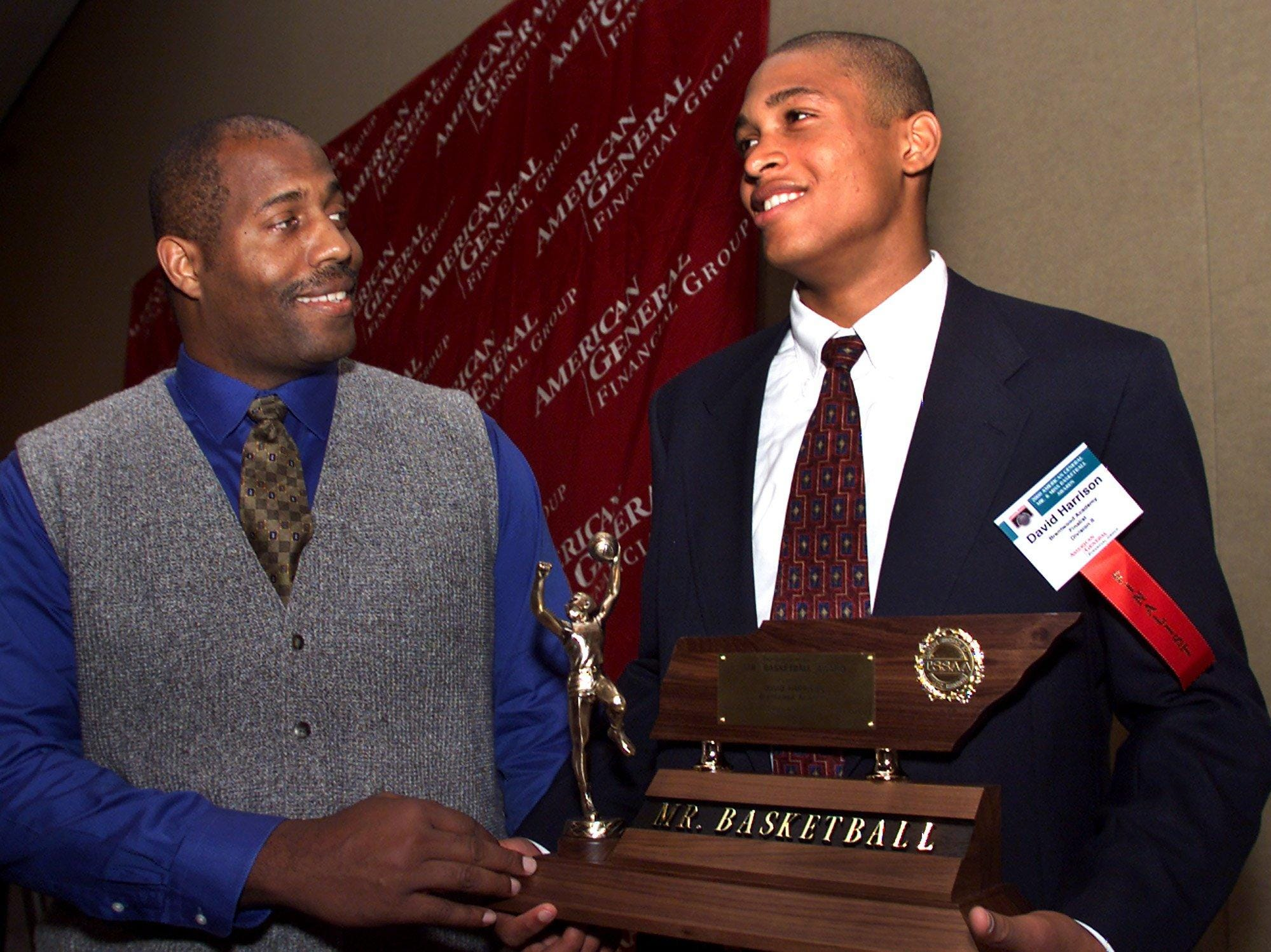 -  -FR 030600 B prepbasket spts---Mr. Basketball in the II division David Harrison (R) with his father Dennis Harrison at the awards banquet. Photo Freeman Ramsey Staff