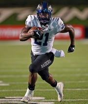 MTSU running back Tavares Thomas carries the ball during the Blue Raiders' 34-24 win over Marshall on Oct. 5, 2018.