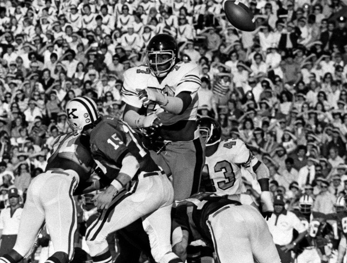 -  -Text: 75VandyvsKentucky12...Vanderbilt defensive tackle (77) Dennis Harrison knocked down the pass from Kentucky quarterback (15) Cliff Hite in its game at Dudley Field. Staff photo by Robert Johnson (The Tennessean) 11/8/1975