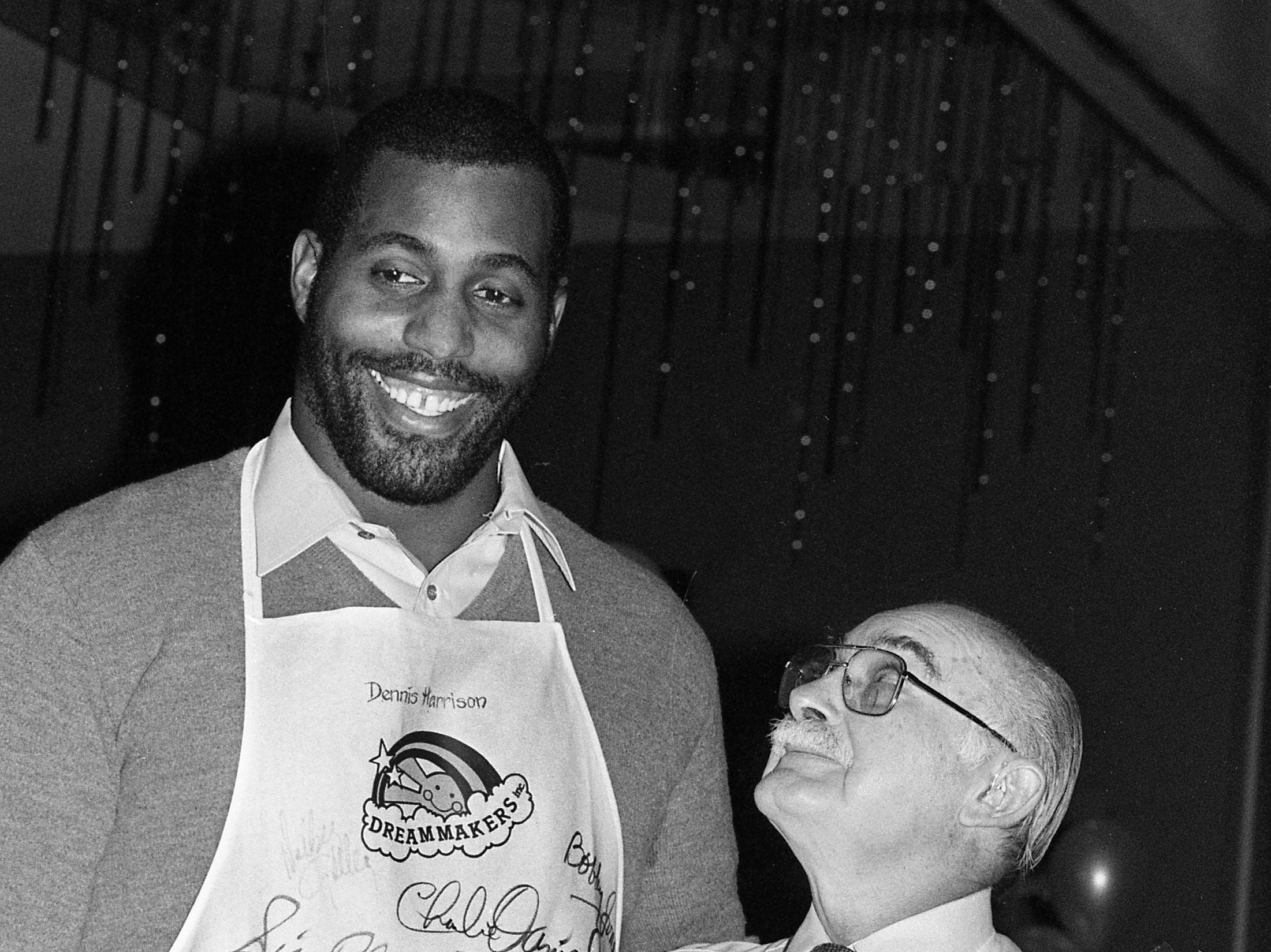 Grand Ole Opry star Grandpa Jones, right, has to look way up at fellow celebrity waiter and pro football player Dennis Harrison during the DreamMakers Celebrity Waiters Luncheon at the Radisson Plaza Hotel March 11, 1986.