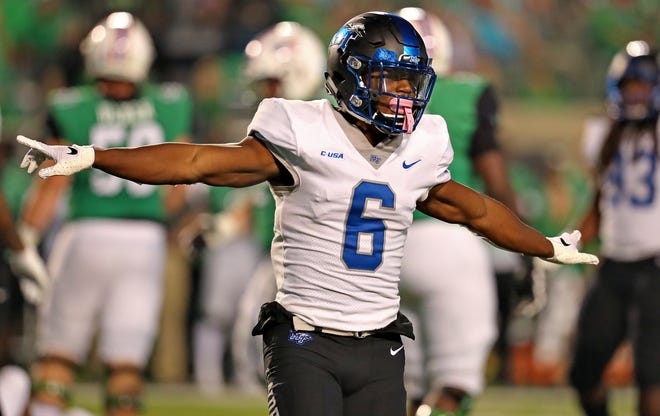 MTSU linebacker Khalil Brooks celebrates after making a play during the Blue Raiders' 34-24 win over Marshall on Friday.