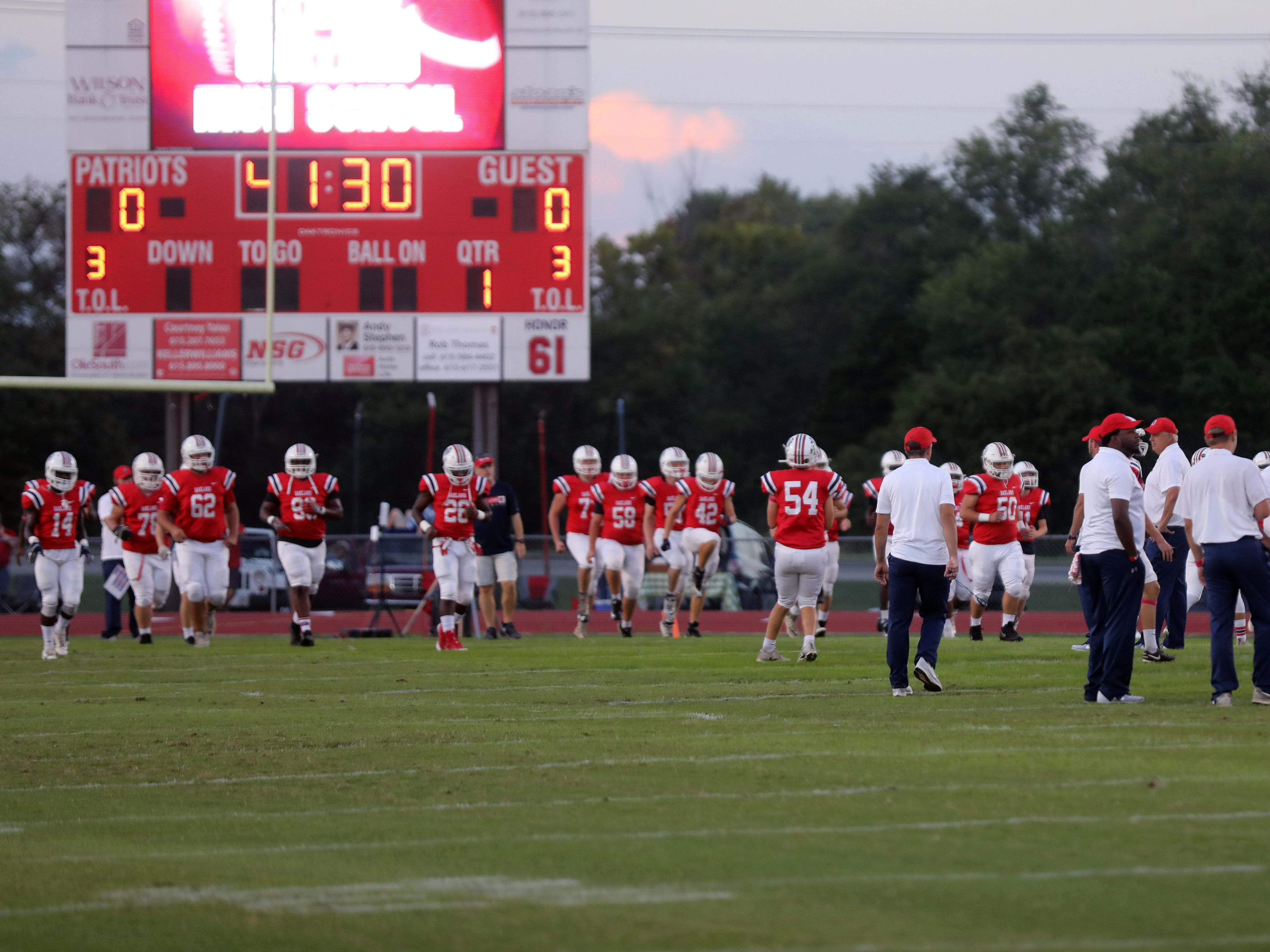 Oakland players and coaches take the field for warmups before their game against Franklin at Oakland High School in Murfreesboro Friday, October 5, 2018.