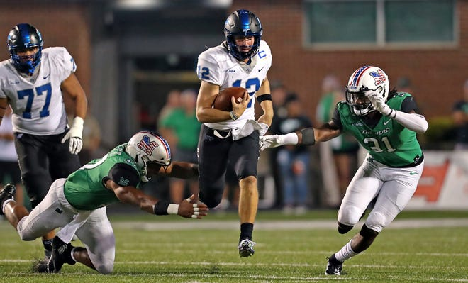 MTSU quarterback Brent Stockstill runs with the ball during the Blue Raiders' 34-24 win over Marshall on Oct. 5, 2018.
