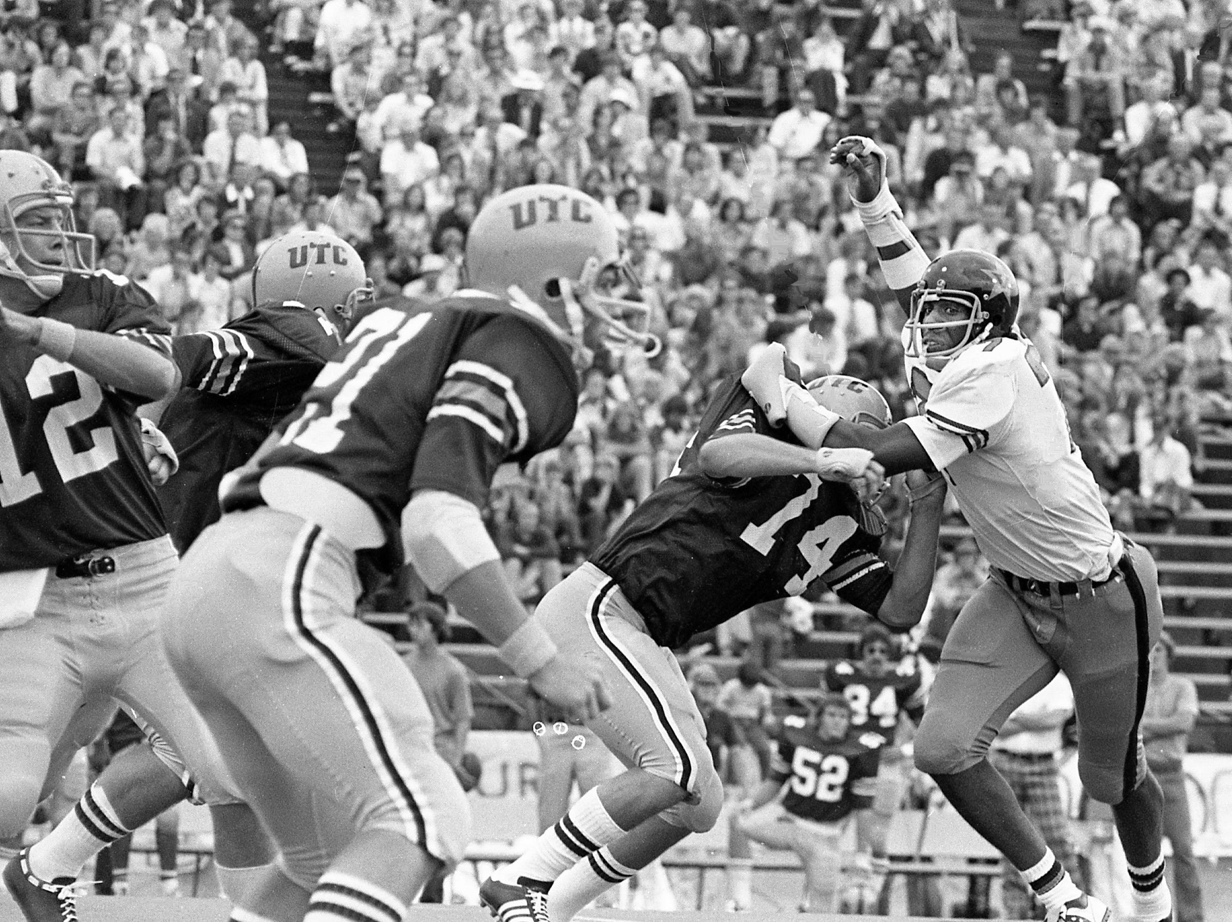 Vanderbilt defensive end Dennis Harrison (77) fights off a lineman from UT-Chattanooga in their opener at Dudley Field Sept. 14, 1974.