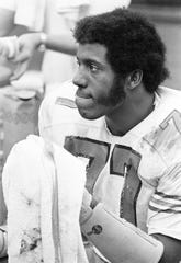 Vanderbilt defensive tackle Dennis Harrison (77) catches his breath while the offense is on the field against Texas Tech Dec. 28, 1974. Harrison was voted the game's Most Valuable Defensive player for his performance in the game.