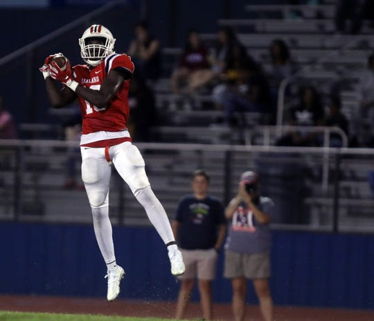 Oakland's DeArre McDonald leaps to intercept a pass intended for a Franklin receiver during their game at Oakland High School in Murfreesboro Friday, October 5, 2018.