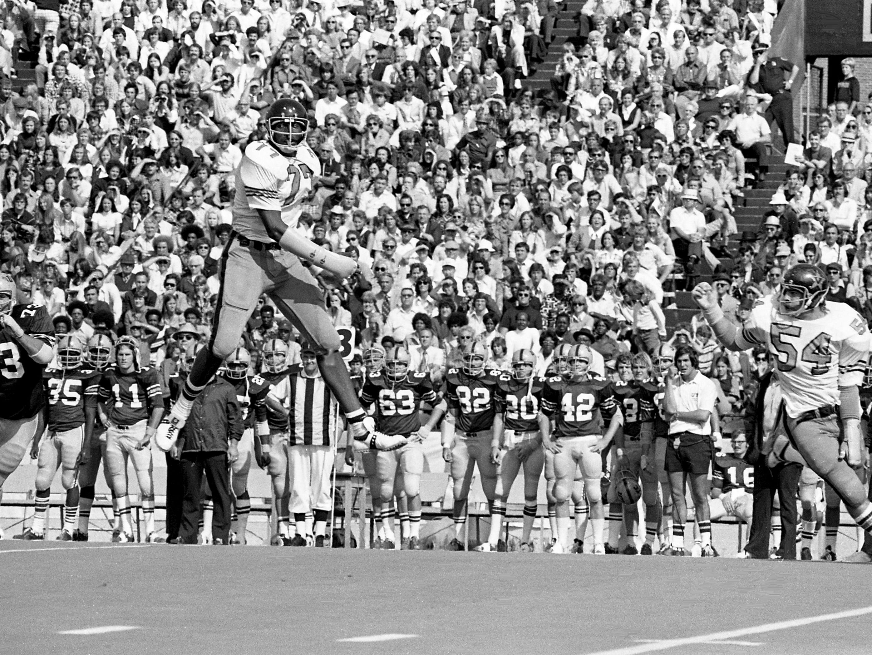 Vanderbilt defensive lineman Dennis Harrison (77) jumps high in the air on a pass play as teammate linebacker Tom Galbierz (54) looks on against UT-Chattanooga at Dudley Field Sept. 14, 1974.