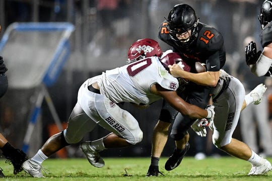 Ensworth's Cole Kennon (12) is tackled by MBA's Ian Hall (50) during the second half at Ensworth High School in Nashville, Tenn., Friday, Oct. 5, 2018.