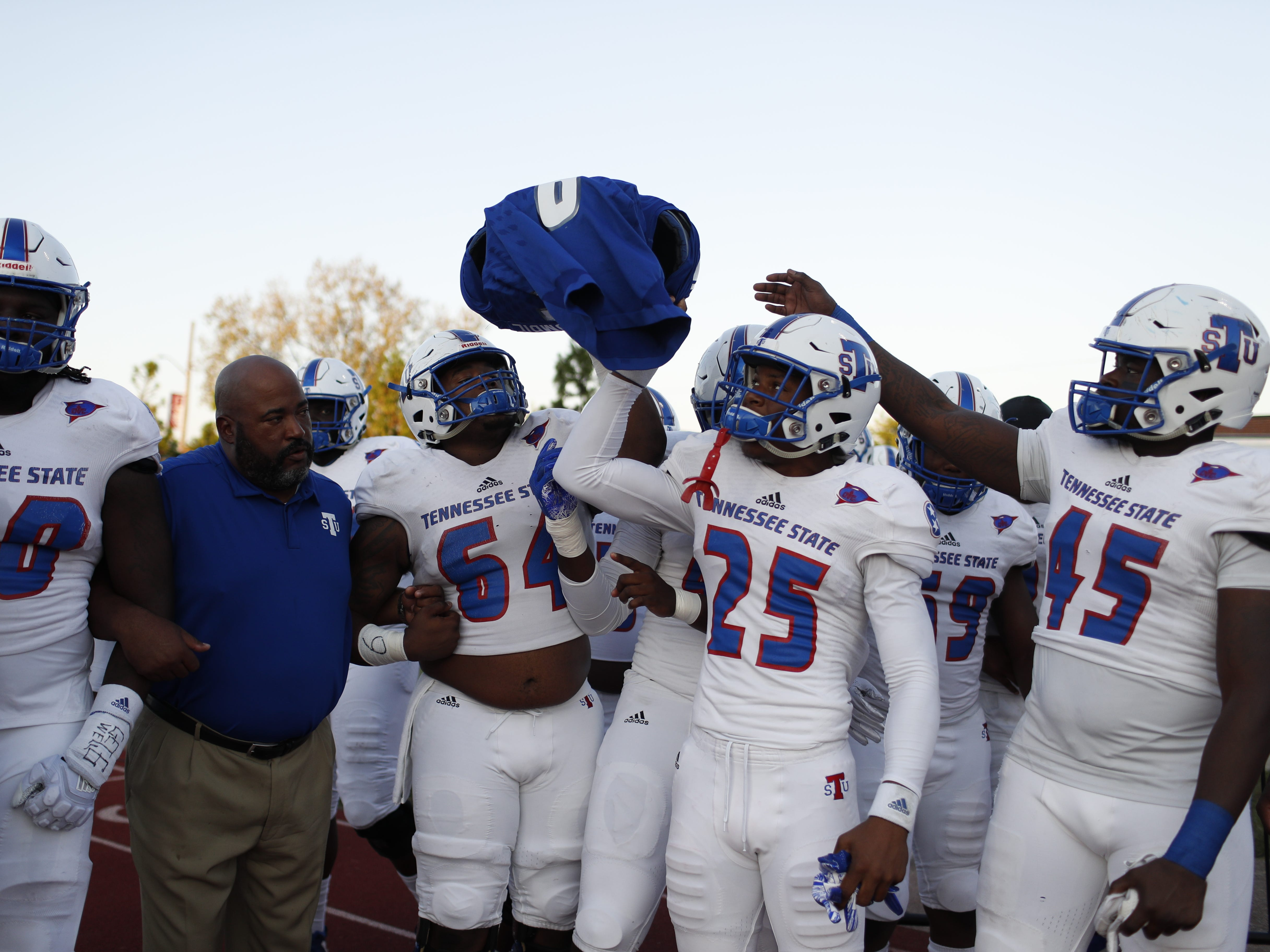 Tennessee State players hold the shoulder pads and jersey of Christion Abercrombie before the Tigers' game at Austin Peay on Saturday, October 6, 2018.