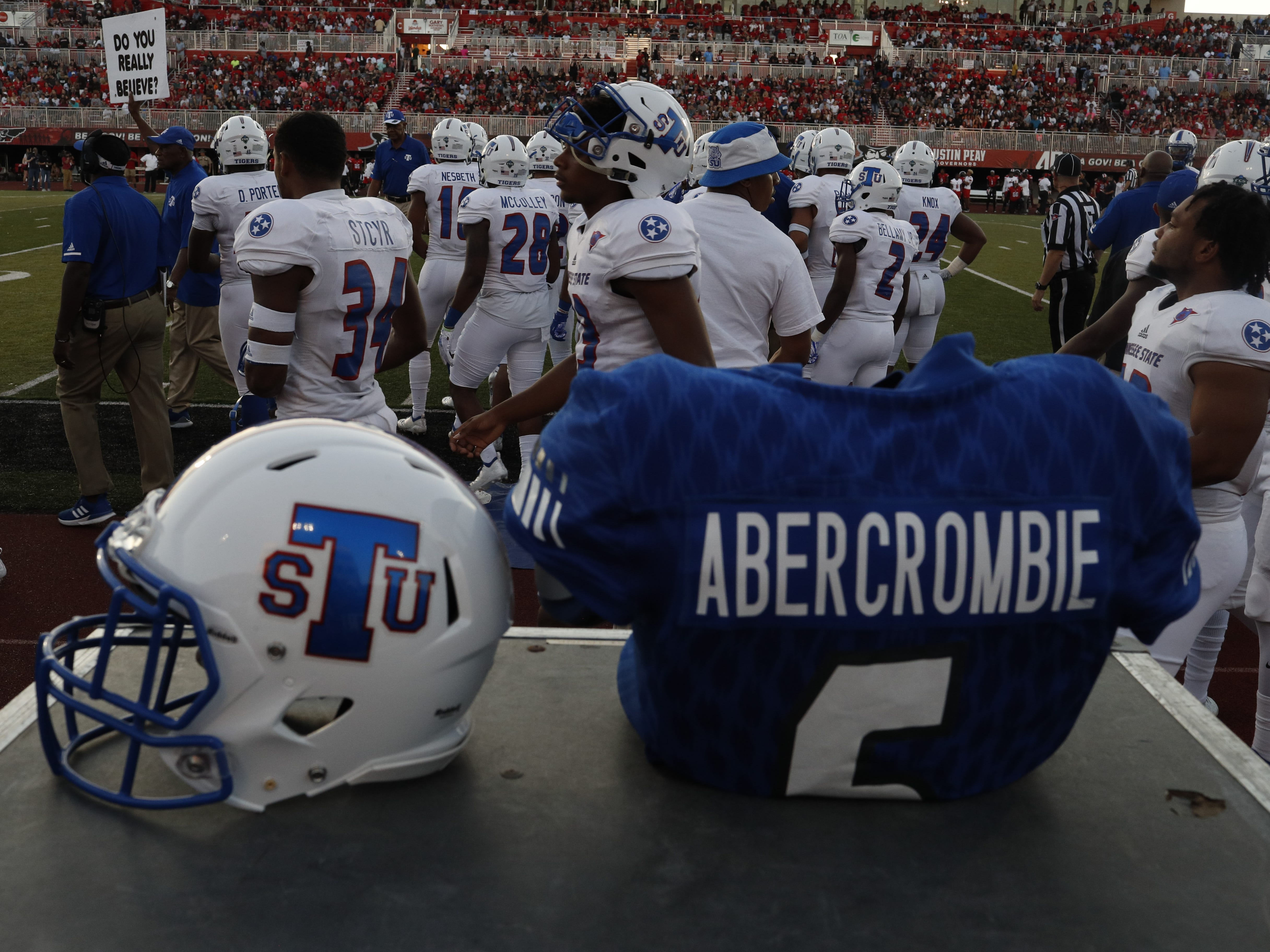 The jersey and shoulder pads of Tennessee State linebacker Christion Abercrombie rests on a equipment box on the sidelines before the Tigers' game at Austin Peay on Saturday, October 6, 2018.