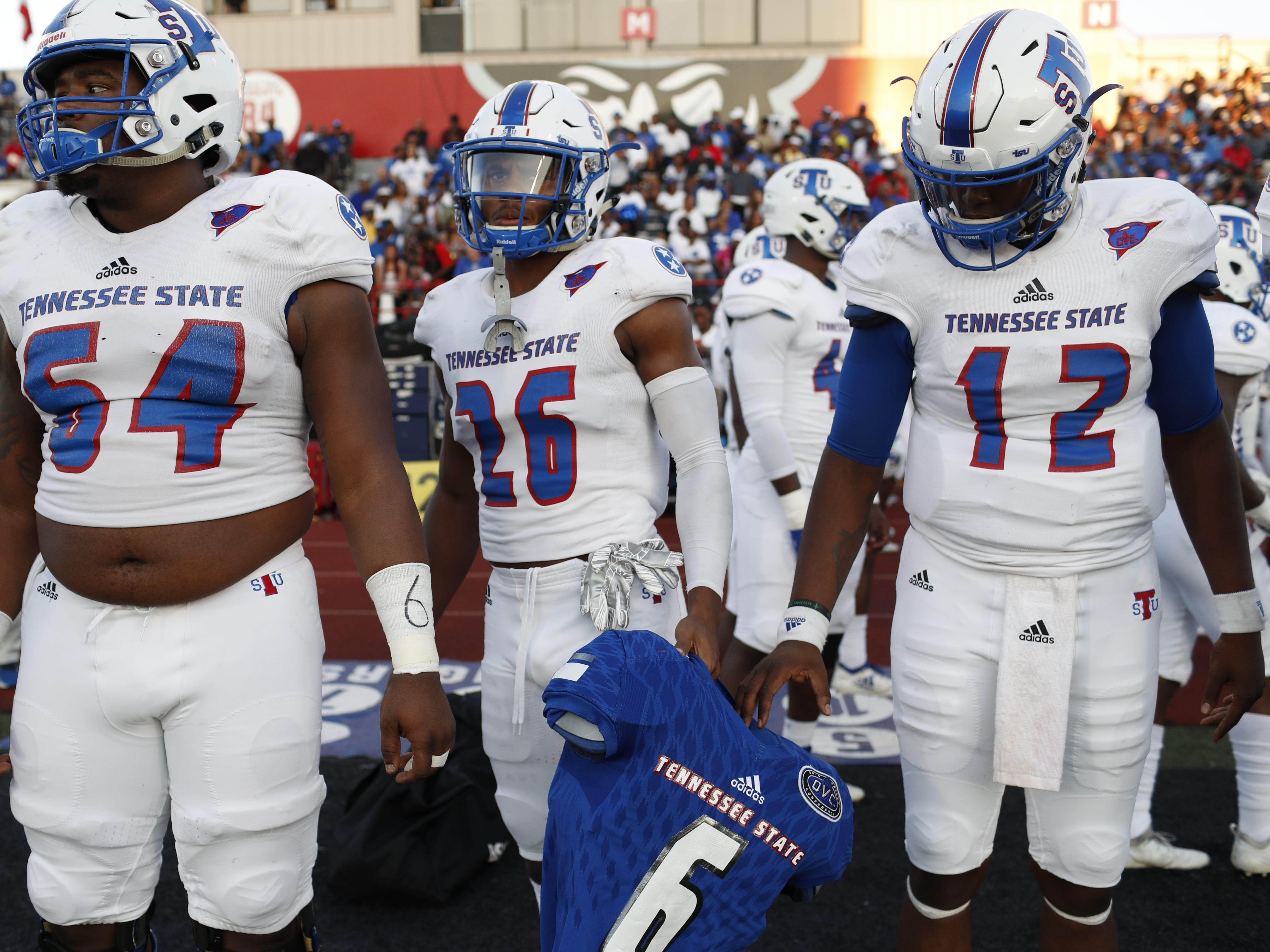 Tennessee State football's captains bring the shoulder pads and jersey of Christion Abercrombie to the coin toss before the Tigers' game at Austin Peay on Saturday, October 6, 2018.