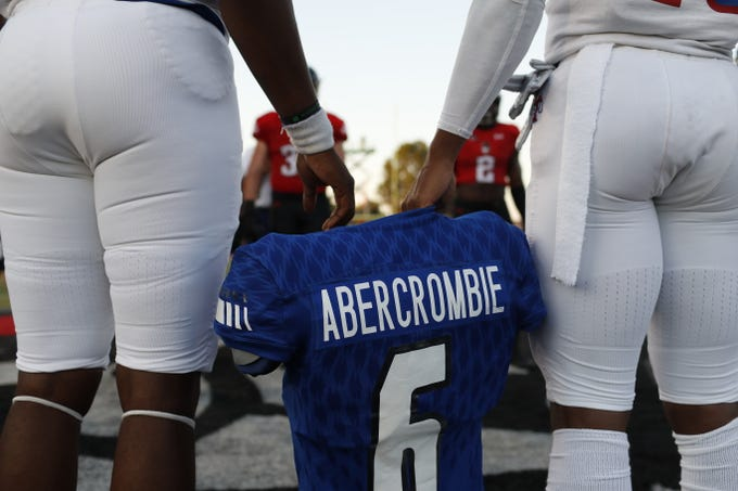 Tennessee State captains hold the shoulder pads and jersey of linebacker Christion Abercrombie before the Tigers' game at Austin Peay on Saturday, October 6, 2018.