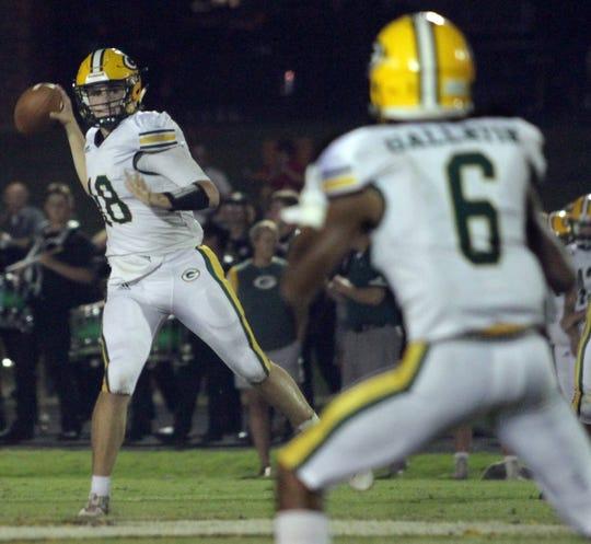 Gallatin quarterback Ander Sloan eyes his receiver against Hendersonville on Friday, October 5, 2018.