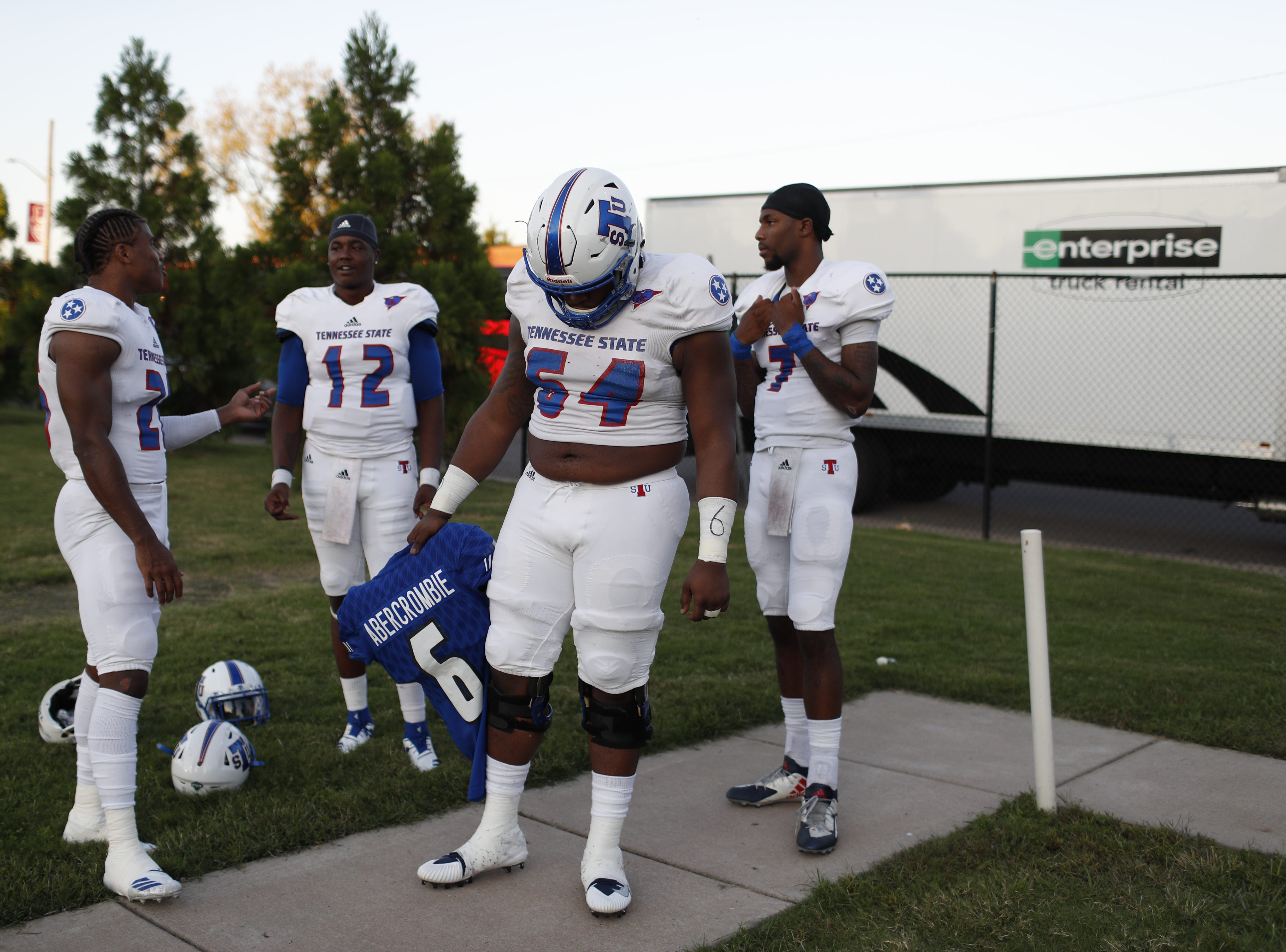 Tennessee State offensive lineman Thomas Burton holds the shoulder pads and jersey of linebacker Christion Abercrombie before the Tigers' game at Austin Peay on Saturday, October 6, 2018.