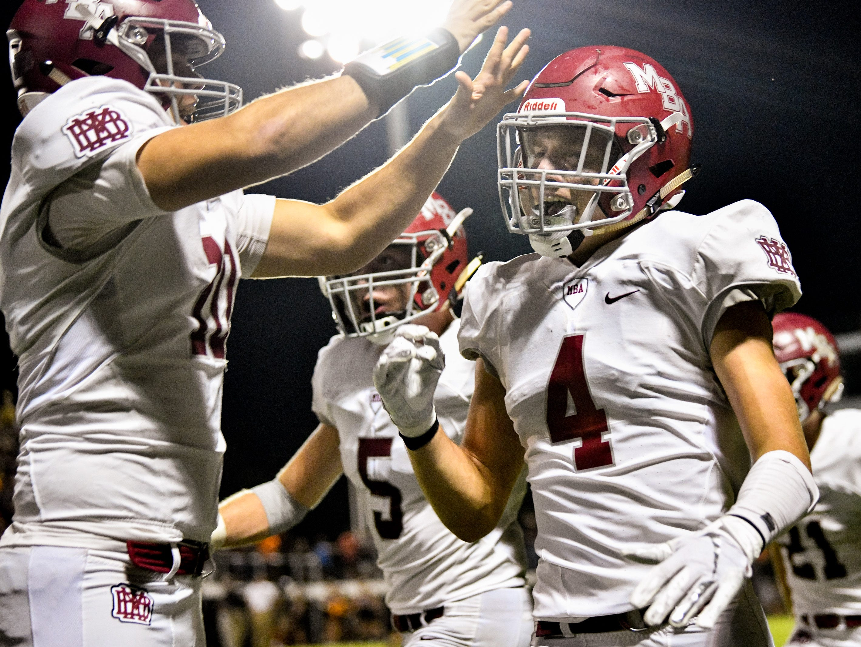 MBA's Tye Herbstreit (4) celebrates scoring a touchdown against Ensworth during the second half at Ensworth High School in Nashville, Tenn., Friday, Oct. 5, 2018.