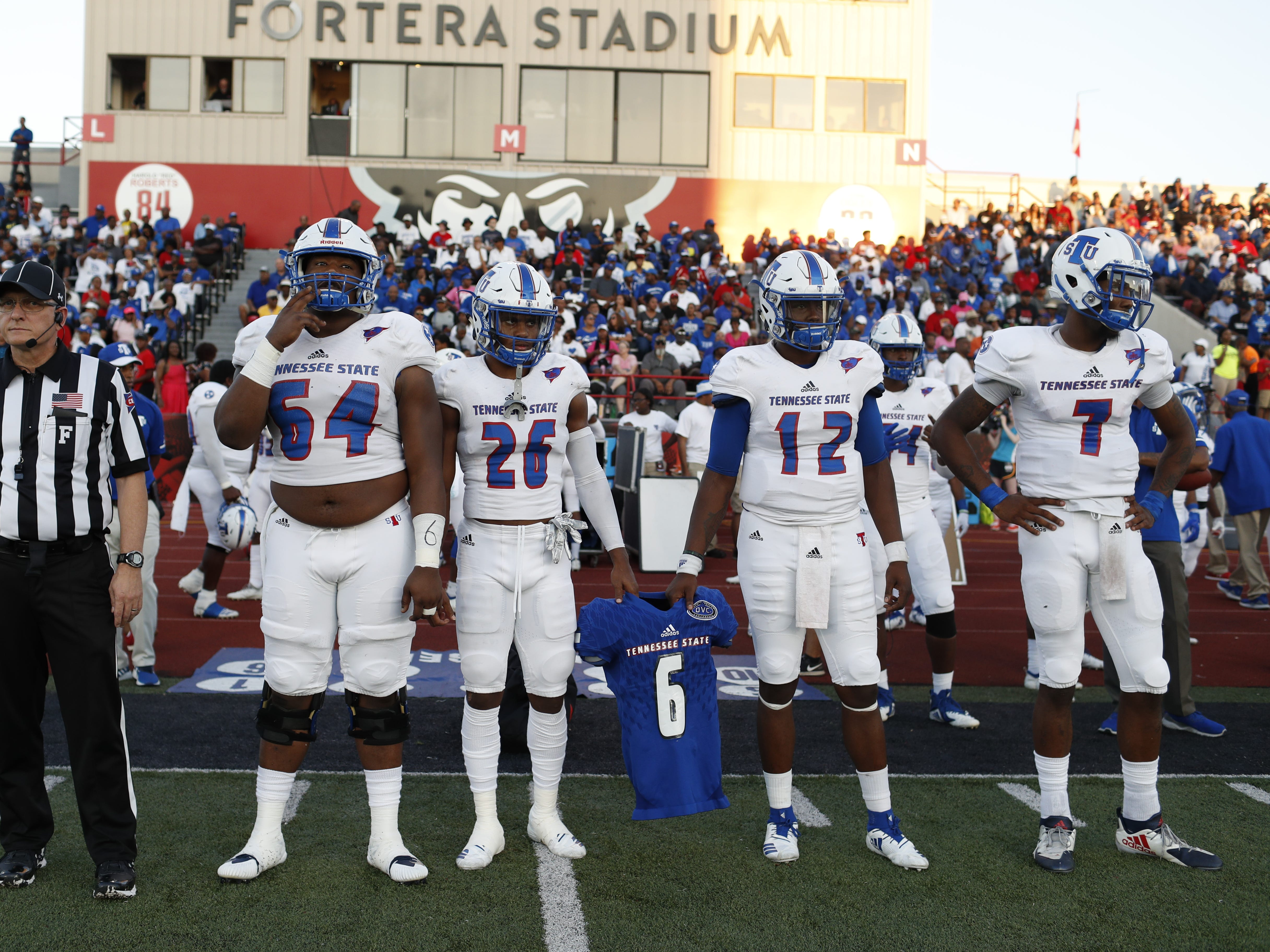 Tennessee State's captains hold the shoulder pads and jersey of linebacker Christion Abercrombie before the Tigers' game at Austin Peay on Saturday, October 6, 2018.