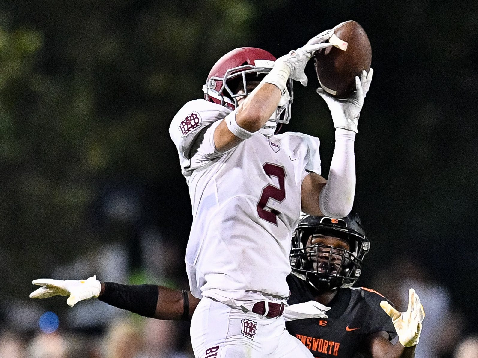 MBA's Jake Herbstreit (2) intercepts a pass intended for Ensworth's Dante Wynn (6) during the second half at Ensworth High School in Nashville, Tenn., Friday, Oct. 5, 2018.