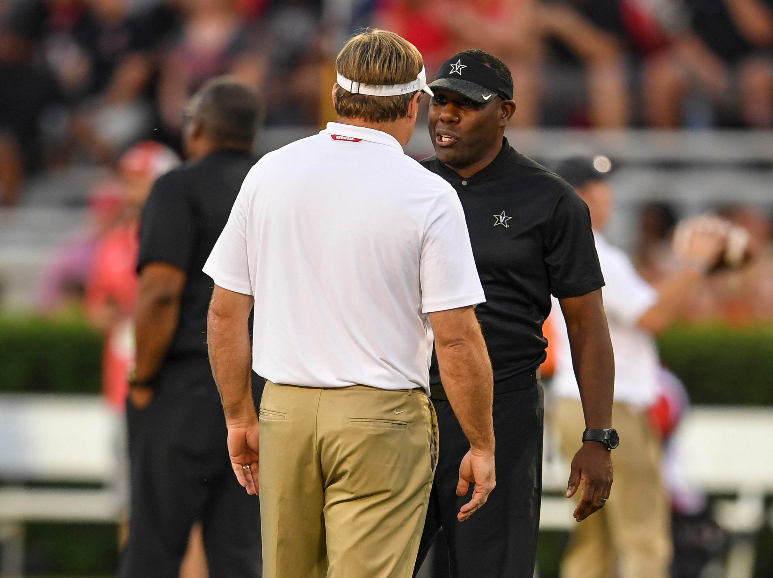Oct 6, 2018; Athens, GA, USA; Georgia Bulldogs head coach Kirby Smart (left) talks to Vanderbilt Commodores head coach Derek Mason on the field prior to the game at Sanford Stadium. Mandatory Credit: Dale Zanine-USA TODAY Sports
