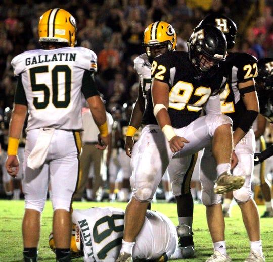 Hendersonville's Austin Halas celebrates a sack of Gallatin quarterback Ander Sloan on Friday, October 5, 2018.