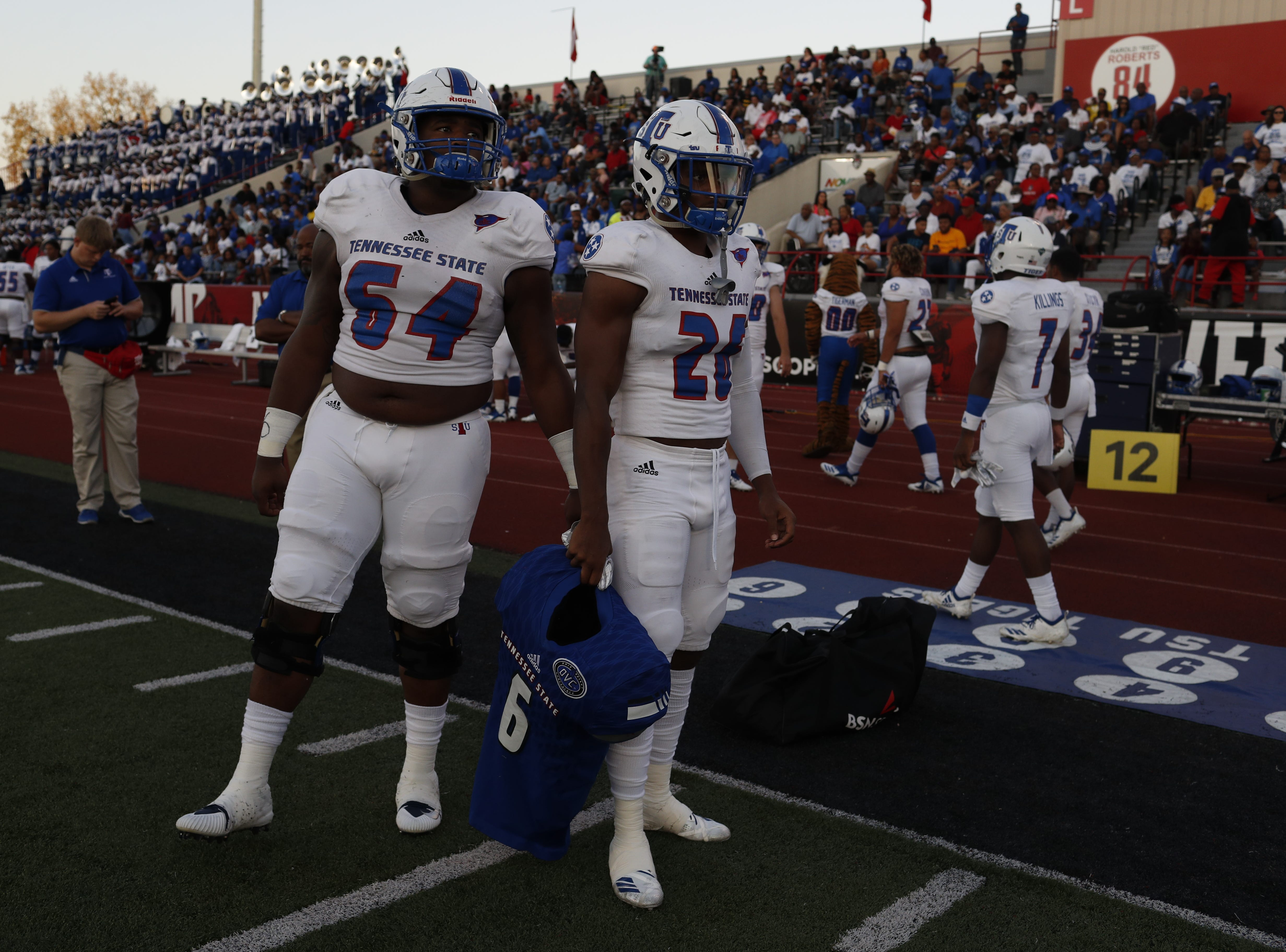 Tennessee State offensive lineman Thomas Burton and safety LaQuarius Cook hold the shoulder pads and jersey of Christion Abercrombie before the Tigers' game at Austin Peay on Saturday, October 6, 2018.