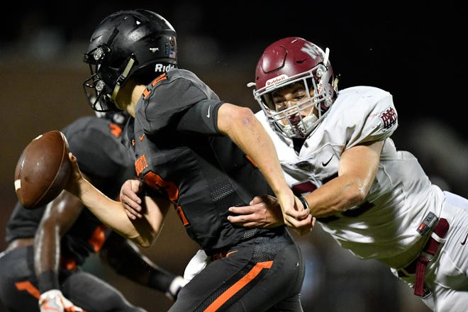 MBA's Hedges Hayworth (32) tackles Ensworth's Cole Kennon (12) during the first half at Ensworth High School in Nashville, Tenn., Friday, Oct. 5, 2018.