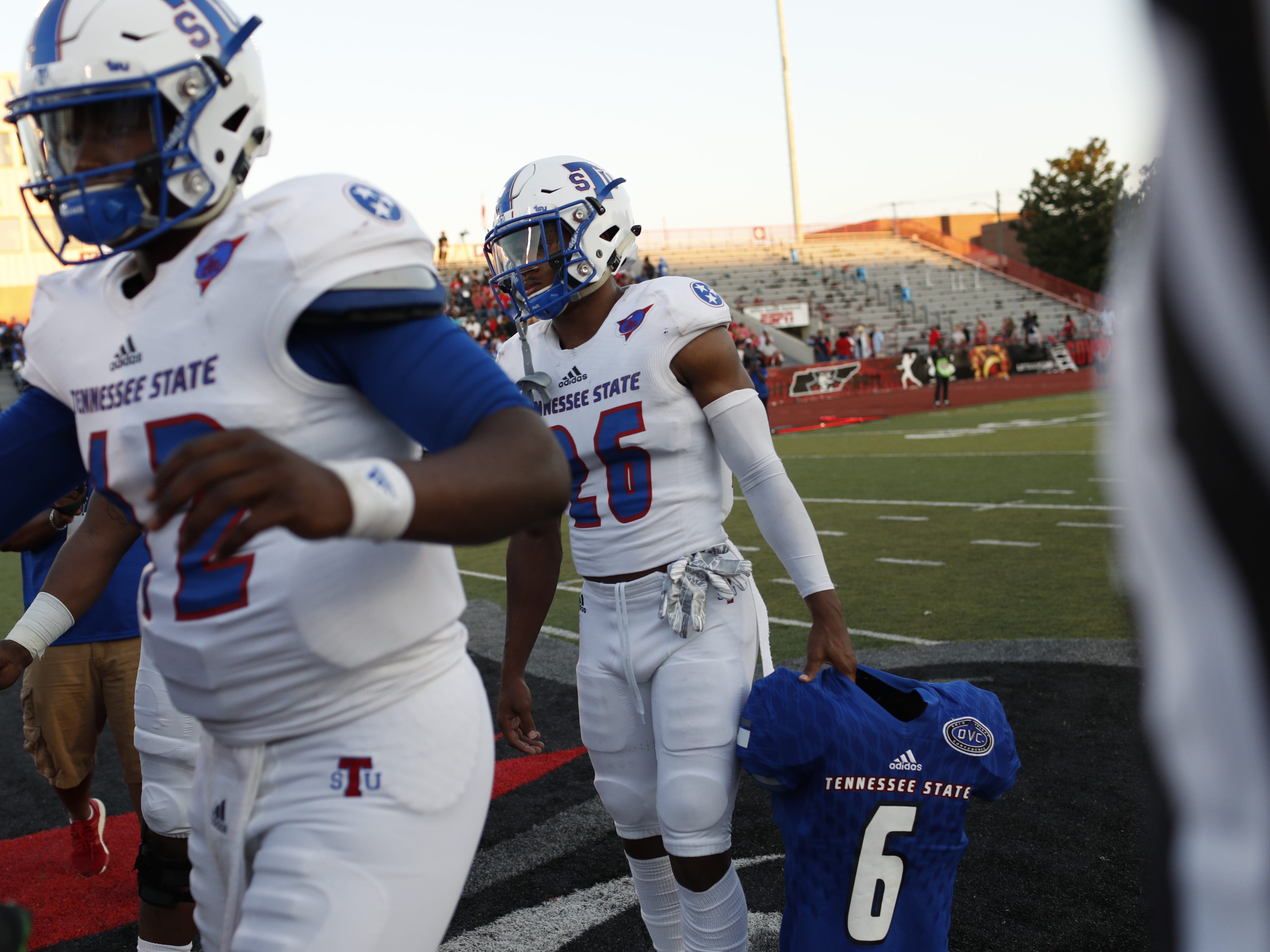 Tennessee State captain LaQuarius Cook holds the shoulder pads and jersey of linebacker Christion Abercrombie before the Tigers' game at Austin Peay on Saturday, October 6, 2018.