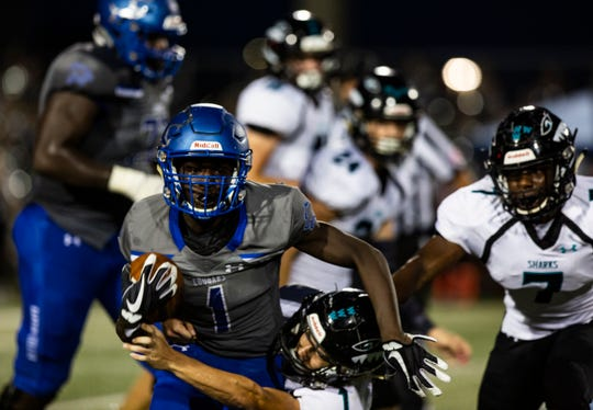 De-sean Duverge of Barron Collier High School runs as the defense tries to tackle him during the annual Catfish Bowl on Friday, October 5, 2018, at Barron Collier High School in Naples.