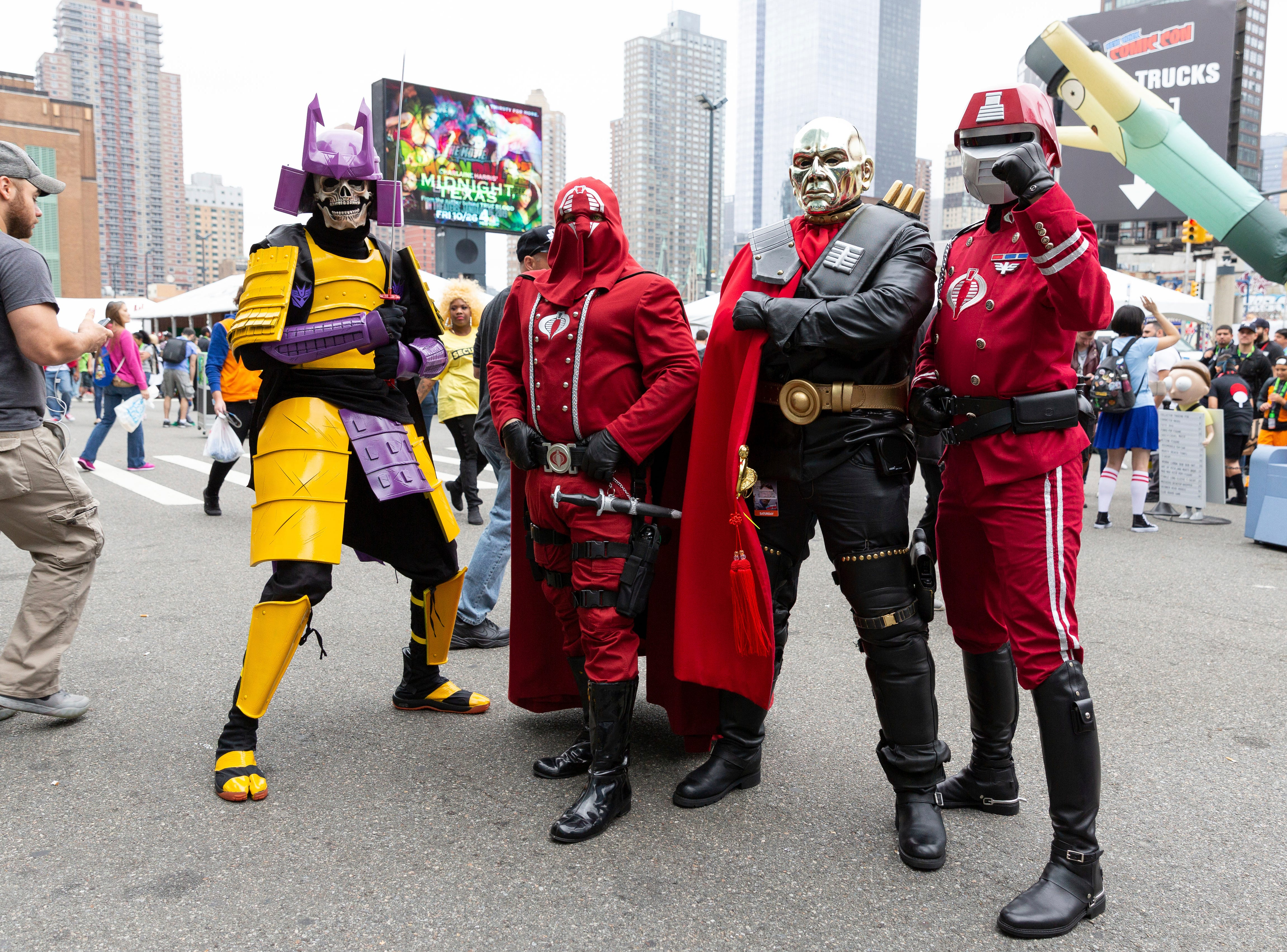 "Attendees dressed as characters from ""G.I. Joe"" pose for a photo on the third day of New York Comic Con, Saturday, Oct. 6, 2018. (AP Photo/Steve Luciano)"
