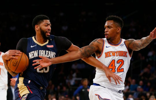 Oct 5, 2018; New York, NY, USA;  New York Knicks forward Lance Thomas (42) defends against New Orleans Pelicans forward Anthony Davis (23) during the first quarter at Madison Square Garden.