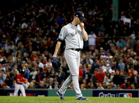 New York Yankees starting pitcher J.A. Happ leaves during the third inning against the Boston Red Sox in Game 1 of a baseball American League Division Series on Friday, Oct. 5, 2018, in Boston.