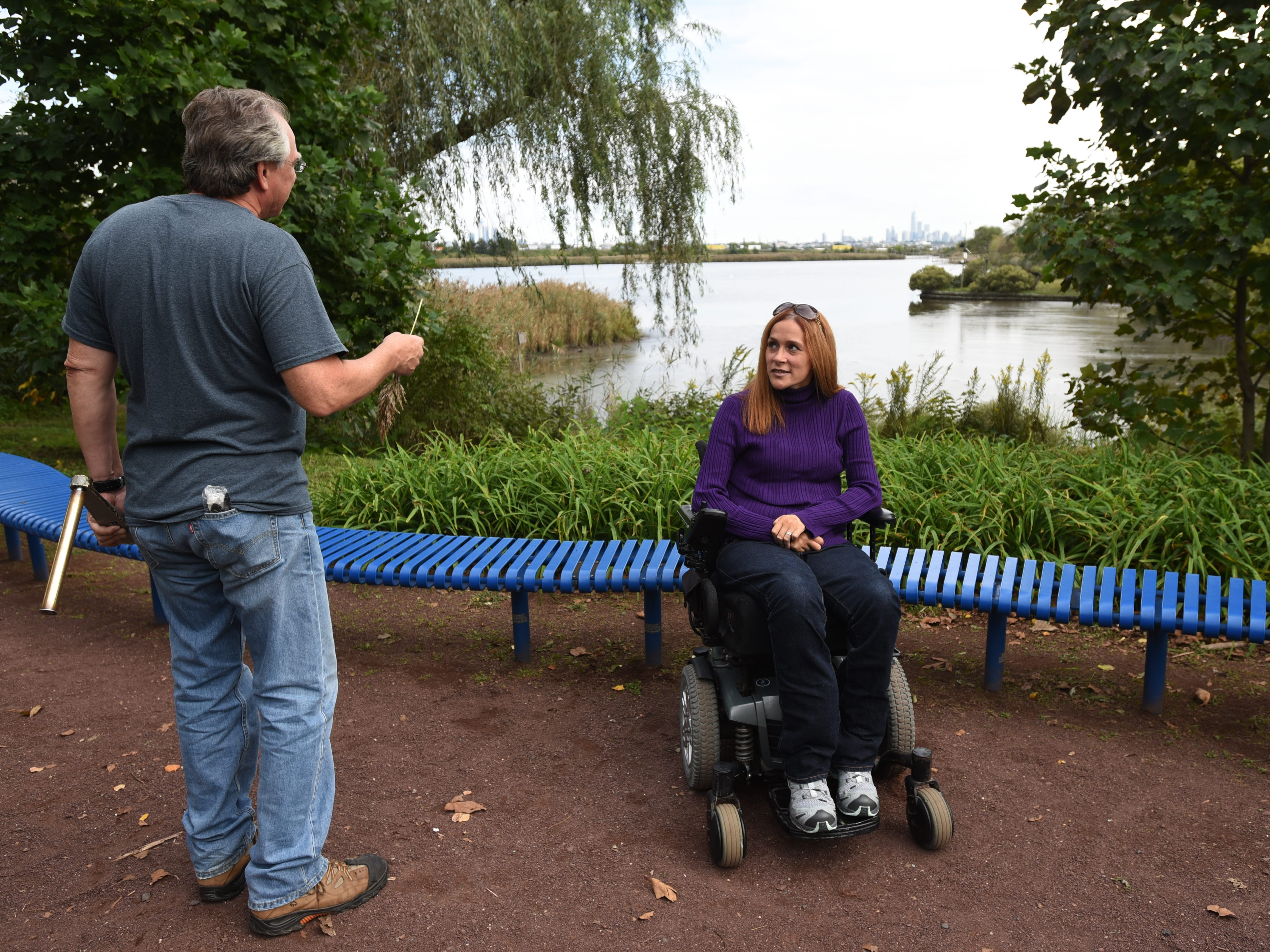 Michele Daly, Director of Disability Education at Meadowlands Environment Center and Ramapo College, talks to a colleague on one of the accessible trails at DeKorte Park. New Jersey's hiking options for those with limited mobility, includes DeKorte Park and its accessible trails in Lyndhurst shown on Friday October 5, 2018.