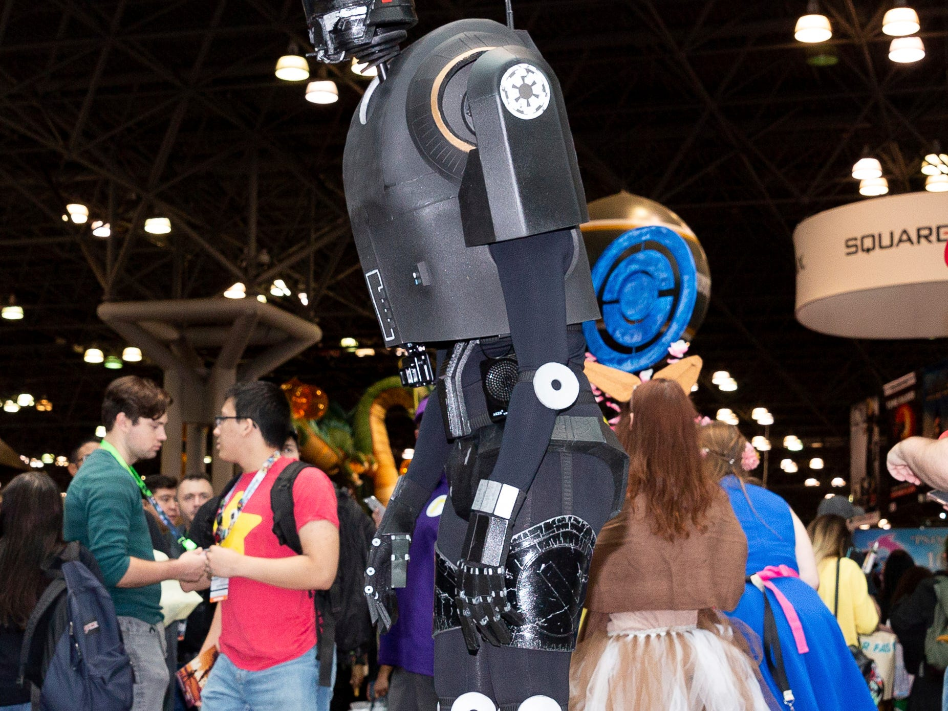 "An attendee dressed as K-2SO from the movie ""Rogue One: A Star Wars Story"" poses for a photo on the third day of New York Comic Con, Saturday, Oct. 6, 2018. (AP Photo/Steve Luciano)"